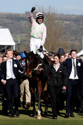 Ruby Walsh riding Douvan win The Sky Bet Supreme Novices' Hurdle Race at Cheltenham racecourse