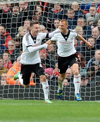 Fulham's Steve Sigwell (right) celebrates with teammate Muamer Tankovic after scoring his sides first goal of the game during the Barclays Premier League match at Old Trafford, Manchester.