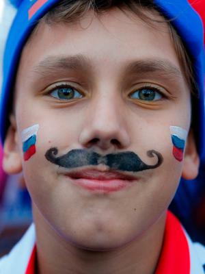 Fans gather in the fan fest of Moscow to watch the Russia 2018 World Cup quarter-final football match between Russia and Croatia on July 7, 2018. / AFP PHOTO / Maxim ZMEYEVMAXIM ZMEYEV/AFP/Getty Images