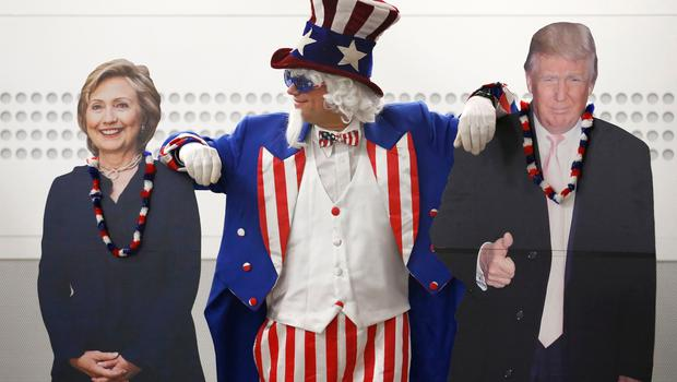 'Uncle Sam' poses with cardboard cut-outs of Hillary Clinton and Donald Trump at a US election party organised by the US Consulate General in Scotland at the University of Edinburgh where party-goers watched TV screens beaming results live from across the Atlantic. PRESS ASSOCIATION Photo. Picture date: Wednesday November 9, 2016. See PA story POLITICS President. Photo credit should read: Jane Barlow/PA Wire