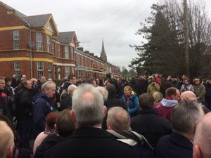 Crowds gather outside the home of Martin McGuinness ahead of his funeral.