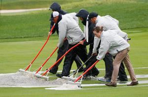 LOUISVILLE, KY - AUGUST 08:  Members of the grounds crew clear water from a fairway during the weather-delayed second round of the 96th PGA Championship at Valhalla Golf Club on August 8, 2014 in Louisville, Kentucky.  (Photo by Sam Greenwood/Getty Images)