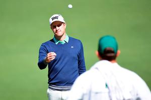 AUGUSTA, GEORGIA - APRIL 07:  Chris Kirk of the United States tosses his ball to caddie David Robinson after putting for birdie on the second green during the first round of the 2016 Masters Tournament at Augusta National Golf Club on April 7, 2016 in Augusta, Georgia.  (Photo by Harry How/Getty Images)