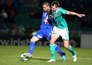 Northern Ireland Gareth McAuley and Israel's Itay Shechter during Tuesday night's World Cup  Group F qualifier match at Windsor Park