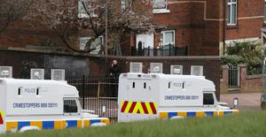 Pacemaker Press 18/4/2016 PSNI officers near the Family Home (of Michael McGibbon) in the Ardoyne area in North Belfast on Monday, As they continue their investigation into the Murder of Michael McGibbon, 33,  who died after an attack in an alleyway at Butler Place, with police saying his killing carried the hallmarks of a paramilitary murder.  A 34-year-old man is still being questioned. Pic Colm Lenaghan/Pacemaker