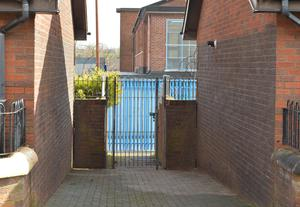 Pacemaker Press 18/4/2016 The  alleyway at Butler Place,  Where Michael McGibbon was shot, The PSNI have said his killing carried the hallmarks of a paramilitary murder.  A 34-year-old man is still being questioned. Pic Colm Lenaghan/Pacemaker