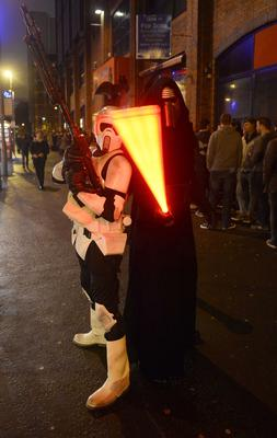"Pacemaker press 16/12/2015 Hundreds of Star Wars fans queue outside the Movie House on the Dublin road in order to see the latest  film "" The Force Awakens"". Pictured are Kylo Rem [in black] and a Biker scout. Picture Mark Marlow/pacemaker press"