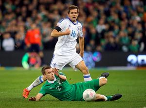 Republic of Ireland's Seamus Coleman and Bosnia and Herzegovina's  Senad Lulic (rear) battle for the ball during the UEFA Euro 2016 Qualifying Playoff second leg at the Aviva Stadium, Dublin. PA
