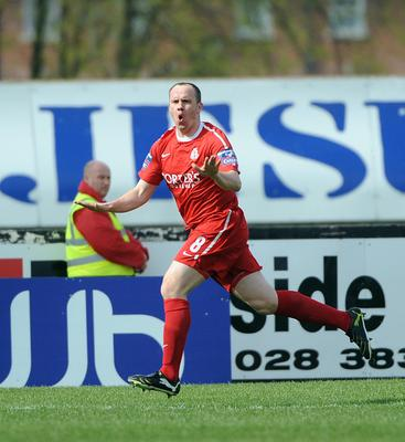 Richard Clarke celebrates scoring for the Ports against Crusaders in the Irish Cup semi-final in 2011.