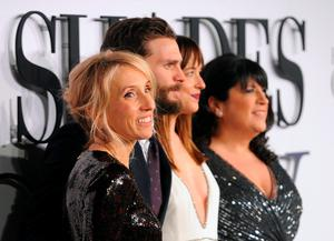 (Left - right) Sam Taylor-Johnson, Jamie Dornan, Dakota Johnson and E L James attending the UK premiere of Fifty Shades of Grey at the Odeon Leicester Square, London. PRESS ASSOCIATION Photo. Picture date: Thursday February 12, 2015. See PA story SHOWBIZ Fifty. Photo credit should read: Dominic Lipinski/PA Wire