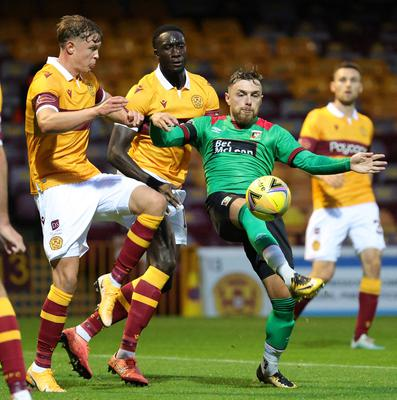 Pacemaker Belfast 27-8-20 Motherwell v Glentoran - Europa League Qualifier Glentoran's Robbie McDaid and Motherwell's Mark O'Hara during this evening's game at Fir Park, Motherwell.  Photo by David Maginnis/Pacemaker Press
