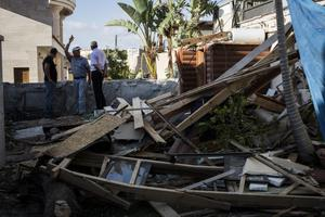 ASHDOD, ISRAEL - JULY 16:  Debris remains after a rocket from Gaza directly hit a house in the city of Ashdod on July 16, 2014, Israel. An Egyptian ceasefire proposal was yesterday refused by Hamas, who continued their missile bombardment on Israel. Israel has today issued a warning to 100,00 residents of northern Gaza to evacuate their homes as it continues with planned airstrikes as part of operation 'Protective Edge'. Israeli Prime Minister Benjamin Netanyahu said he had 'no choice' but to intensify the military operation in light of the refusal to ceasefire terms from Hamas officials.  (Photo by Ilia Yefimovich/Getty Images)
