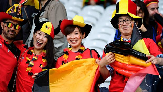 Belgium supporters wait for the start of the Euro 2016 quarter-final football match between Wales and Belgium at the Pierre-Mauroy stadium in Villeneuve-d'Ascq near Lille, on July 1, 2016. / AFP PHOTO / MIGUEL MEDINAMIGUEL MEDINA/AFP/Getty Images