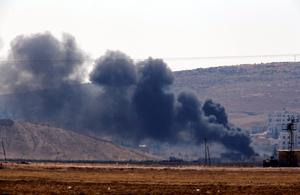 Smoke from a fire rises after a shell landed in Kobani in Syria as fighting intensifies between Syrian Kurds and the militants of Islamic State group, as seen from the outskirts of Suruc, at the Turkey-Syria border, Monday, Oct. 6, 2014. Kobani, also known as Ayn Arab and its surrounding areas have been under attack since mid-September, with militants capturing dozens of nearby Kurdish villages. (AP Photo/Lefteris Pitarakis)