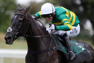 UTTOXETER, ENGLAND - JULY 16:  Tony McCoy riding On The Record (L) clear the last to win The 32Red On The App Store Handicap Hurdle Race drawing level with trainer Martin Pipe on winners of 4,191 at Uttoxeter racecourse on July 16, 2014 in Uttoxeter, England. (Photo by Alan Crowhurst/Getty Images)