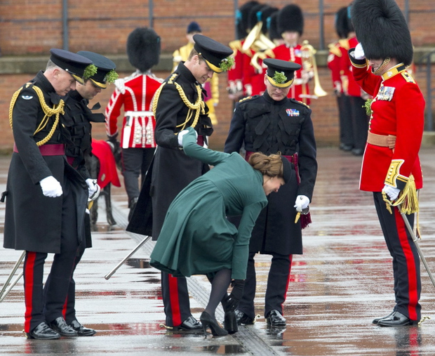 The Duchess of Cambridge had to be helped by Prince William when her heel got stuck in the grating while they take part in a St Patrick's Day parade as they visit Aldershot Barracks.