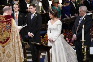The Duke of York (right) stands next to his daughter Princess Eugenie and her groom Jack Brooksbank during their wedding ceremony (Danny Lawson/PA)