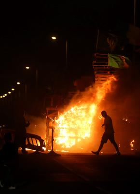 """A bonfire is lit on the Shankill Road in Belfast on the """"Eleventh night"""" to usher in the Twelfth commemorations. PA"""