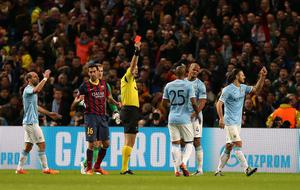Manchester City's Martin Demichelis reacts after being shown a red card during the UEFA Champions League, Round of 16 match at the Etihad Stadium, Manchester. PRESS ASSOCIATION Photo. Picture date: Tuesday February 18, 2014. See PA story SOCCER Man City. Photo credit should read: Peter Byrne/PA Wire