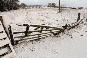 """Snow covers a fence in Greenloaning, near Stirling, as blizzard conditions are set to bring """"a real taste of winter to the whole of the UK"""". Andrew Milligan/PA Wire"""