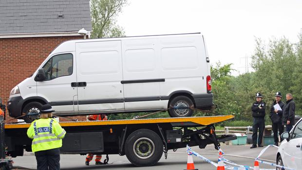 A white Vauxhall Movano van is taken away on a low loader (Rod Minchin/PA)