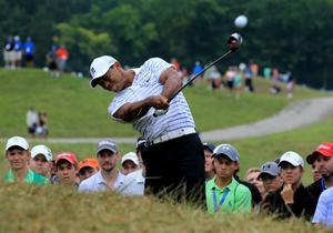 LOUISVILLE, KY - AUGUST 08:  Tiger Woods of the United States hits an approach shot from the rough on the sixth hole during the second round of the 96th PGA Championship at Valhalla Golf Club on August 8, 2014 in Louisville, Kentucky.  (Photo by David Cannon/Getty Images) *** BESTPIX ***