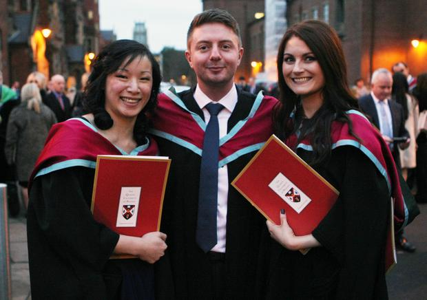 Mandatory Credit - Picture by Freddie Parkinson/Press Eye © Thursday 8th December 2016 Graduations take place at Queens University in Belfast. Tina Ho from Newtownabbey,Michael Kavanagh from Belfast and Lauren St Ledger from Belfast