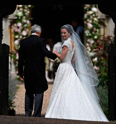 The Duchess of Cambridge's sister Pippa Middleton arrives with their father Michael Middleton, at St Mark's church in Englefield, Berkshire, for her wedding to her millionaire groom James Matthews at an event dubbed the society wedding of the year. PRESS ASSOCIATION Photo. Picture date: Saturday May 20, 2017. See PA story ROYAL Pippa. Photo credit should read: Justin Tallis/PA Wire