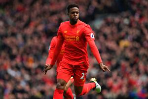Liverpool's Belgian striker Divock Origi celebrates after scoring their third goal during the English Premier League football match between Liverpool and Everton at Anfield in Liverpool, north west England on April 1, 2017. / AFP PHOTO / Paul ELLIS / RESTRICTED TO EDITORIAL USE. No use with unauthorized audio, video, data, fixture lists, club/league logos or 'live' services. Online in-match use limited to 75 images, no video emulation. No use in betting, games or single club/league/player publications.  / PAUL ELLIS/AFP/Getty Images