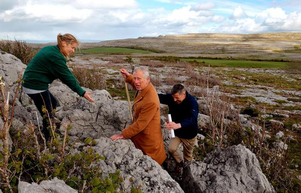 Britain's Prince Charles, Prince of Wales (C) walks with BurrenBeo Trust Project Manager Brendan Dunford, (R) and Trust Coordinator Brigid Barry during his visit to the Burren, a vast area of limestone rock, at Burren National Park in west Ireland, on May 19, 2015. Prince Charles on Tuesday became the first British royal to meet Irish republican leader Gerry Adams, on a visit that will take him to the scene of his great-uncle's murder by the IRA.  AFP PHOTO / POOL / JOHN STILLWELLJOHN STILLWELL/AFP/Getty Images