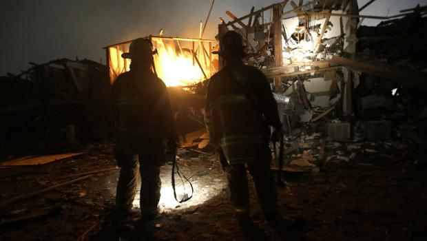 Firefighters us flashlights to search a destroyed apartment complex near a fertilizer plant that exploded earlier in West, Texas, in this photo made early Thursday, April 18, 2013.  (AP Photo/LM Otero)
