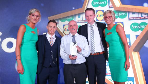 CHARITY CHAMPION Aidan Crawford from Ballymena was named Charity Champion at the Sunday Life Spirit of Northern Ireland Awards. Presenting Aidan with his award is Conor Boyle from category sponsor Lidl along with IBF bantamweight world champion Ryan Burnett. Also pictured are ambassadors from title sponsor Specsavers, Nicola and Alison Crimmins. Aidan was one of ten winners on the night which was held at the Culloden Resort and Spa.