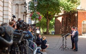 DUP leader Arlene Foster speaks to the media while DUP deputy leader Nigel Dodds and MP Sir Jeffrey Donaldson look on outside 10 Downing Street in London after the party agreed a deal to support the minority Conservative government.  Dominic Lipinski/PA Wire