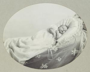 Previously unpublished family photograph issued by the Royal Collection of Queen Elizabeth II in her cot aged five weeks in 1926. The pictures are to be seen by the public for the first time to coincide with a book being released this week to mark the birth of Prince George contains new pictures which show the future Queen between the ages of two and four