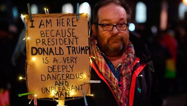 Demonstrators protest outside Downing Street against US President Donald Trump in central London on January 30, 2017.  President Trump signed an executive order on January 27, 2016 restricting immigration from seven Muslim countries. / AFP PHOTO / BEN STANSALLBEN STANSALL/AFP/Getty Images