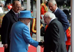 President of Ireland Michael D. Higgins (2nd right) is greeted by Queen Elizabeth II and Prince Philip (left) outside Windsor Castle in Berkshire