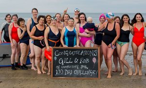 Rob Brown and Gillian Armstrong and fellow swimmers helping them celebrate their 100-day challenge