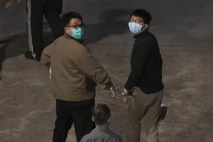 Hong Kong pro-democracy activists Joshua Wong, right, and Ivan Lam, left, are escorted to prison, in Hong Kong last week. China's crackdown on freedoms in the territory has inflamed tensions between Washington and Beijing (Kin Cheung/AP)