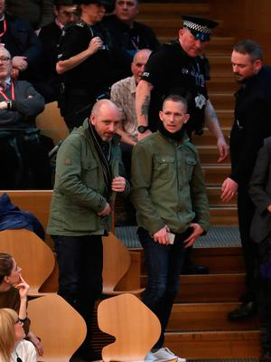The protestors are removed from the public gallery in the debating chamber after interrupting FMQs at the Scottish Parliament in Edinburgh. Andrew Milligan/PA Wire