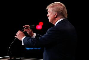 LAS VEGAS, NV - OCTOBER 19:  Republican presidential nominee Donald Trump adjusts the microphone during the third U.S. presidential debate at the Thomas & Mack Center on October 19, 2016 in Las Vegas, Nevada. Tonight is the final debate ahead of Election Day on November 8.  (Photo by Joe Raedle/Getty Images)