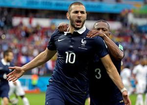 Goal-den moment: France's Karim Benzema celebrates with Patrice Evra after scoring his side's first goal in the Group E battle