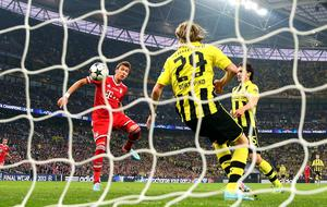 LONDON, ENGLAND - MAY 25:  Mario Mandzukic of Bayern Muenchen scores a goal during the UEFA Champions League final match between Borussia Dortmund and FC Bayern Muenchen at Wembley Stadium on May 25, 2013 in London, United Kingdom.  (Photo by Alex Livesey/Getty Images)