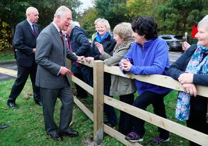 The Prince of Wales meets well-wishers outside the YMCA Londonderry at Drumahoe, in Londonderry, during a visit to communities hit by the summer's flash floods.  Brian Lawless/PA Wire