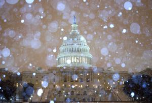 WASHINGTON, DC - FEBRUARY 13: Snow falls in front of the U.S. Capitol building on February 13, 2014 in Washington, DC. The east coast was hit with a winter snow storm with the Washington area expecting up to 8 inches of snow before it ends.  (Photo by Mark Wilson/Getty Images)