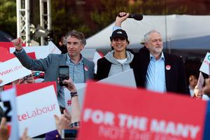 Labour Party leader Jeremy Corbyn (R) stands with comedian Steve Coogan (L) and supporter, Saffiyah Khan (C) at a general election campaign event in Birmingham, central England, on June 6, 2017.AFP/Getty Images