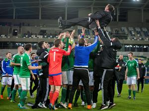 Northern Ireland manager Michael O'Neill is lifted into the air by his players after the UEFA European Championship Qualifying match at Windsor Park, Belfast. PRESS ASSOCIATION Photo. Picture date: Thursday October 8, 2015. See PA story SOCCER N Ireland. Photo credit should read: Liam McBurney/PA Wire.