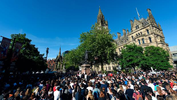People gather for a vigil in Albert Square outside Manchester Town Hall in Manchester after attack at concert. Photo credit should read: Joe Giddens/PA Wire