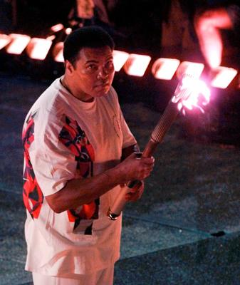 In this July 19, 1996, file photo, Muhammad Ali watches as the flame climbs up to the Olympic torch during the opening ceremonies of the Summer Olympics, in Atlanta. Ali, the magnificent heavyweight champion whose fast fists and irrepressible personality transcended sports and captivated the world, has died according to a statement released by his family Friday, June 3, 2016. He was 74. (AP Photo/Doug Mills, File)