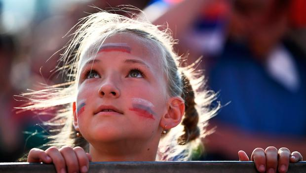 A Russia's fan watches on giant screen at the Fans Zone of Ekaterinburg, the Russia 2018 World Cup Group A football match between Uruguay and Russia on June 25, 2018. / AFP PHOTO / Anne-Christine POUJOULATANNE-CHRISTINE POUJOULAT/AFP/Getty Images