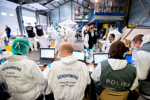 Forensic experts of the French gendarmerie disaster victim identification unit (UGIVC) working under a tent near the site of the March 24 crash of a Germanwings Airbus A320 in which all 150 people on board were killed.